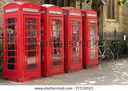 Four red telephone boxes in Cambridge, UK - stock photo
