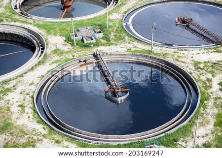 Four round full water settlers for sewage recycling - stock photo