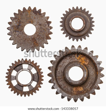 Four rusty gears isolated on a white background. - stock photo