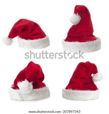Four Santa Claus hat on white background - stock photo