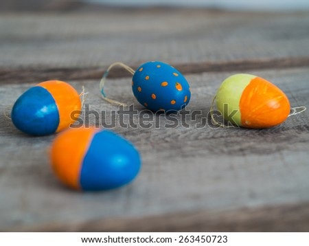 Four selfmade painted easter eggs on a wooden table - selective focus - stock photo