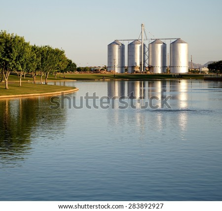 Four Silos in Front of a Lake - stock photo