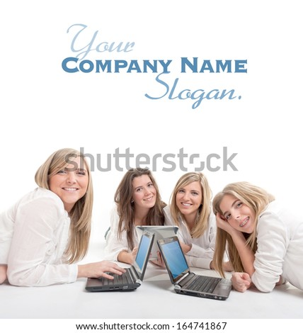 Four smiling girls on the floor with mini computers and pc tablets  - stock photo