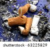 Four smoked cigarettes in a dirty ashtray - stock photo