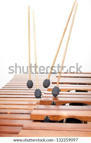 Four Sticks Falling On Marimba. - stock photo