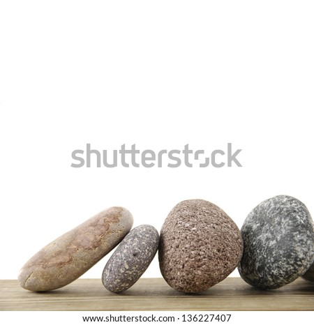 Four stones on a wood board - stock photo