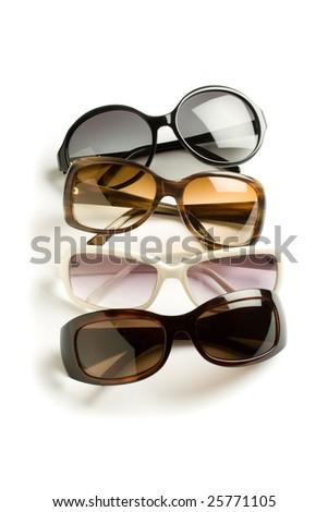 four stylish sunglasses isolated on white - stock photo