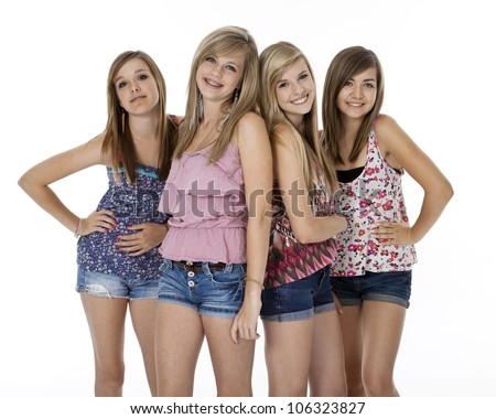 Four teenage girls in summer clothes standing, isolated on white. - stock photo