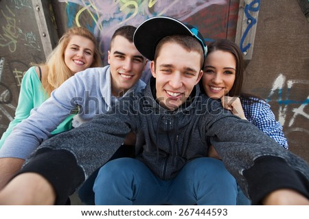 Four teenagers posing for a selfie - stock photo
