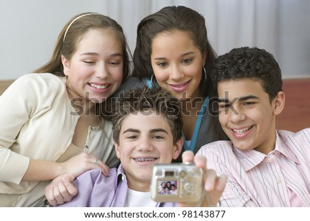 Four teenagers posing for picture - stock photo