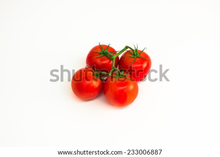 Four tomatoes on a vine isolated against white - stock photo