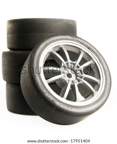 Four used race tires on white background - stock photo