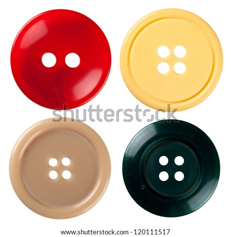 Four varied sewing buttons isolated on white background. Each one is shot separately - stock photo