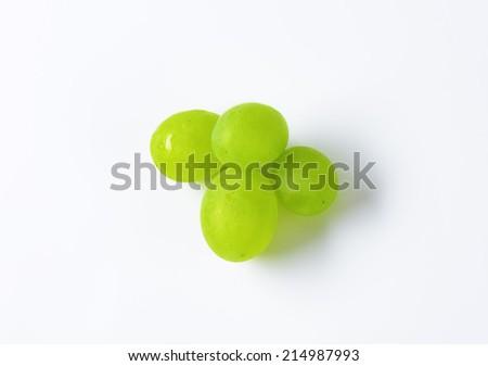 four white grapes on white background - stock photo