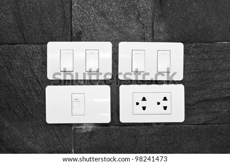 Four white wall mounted electrical plates - stock photo