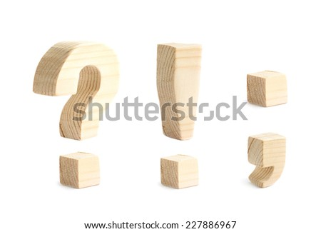Four wooden punctuation marks isolated over the white background, question and exclamation marks, dot and comma - stock photo
