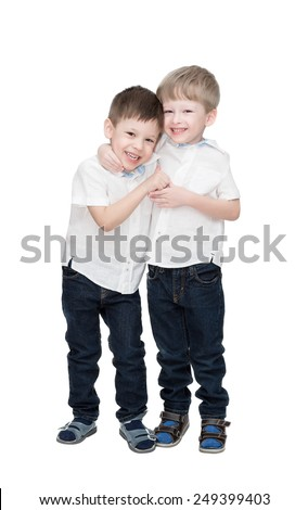 Four-year-old boys of twins, in white linen shirts, one embraces another, isolated on the white - stock photo
