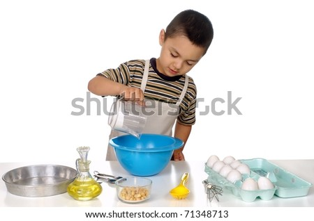 four year old Hispanic boy mixing baking ingredients together in a bowl, on white background - stock photo