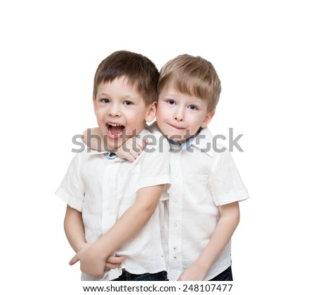 Four-year-old twins boys, in white linen shirts, one embraces another, isolated on the white - stock photo