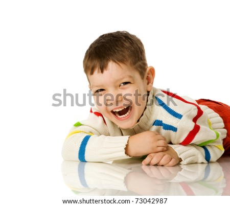 Four years boy lying on floor isolated on white - stock photo