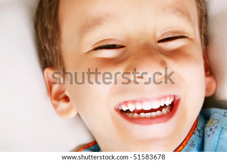 Four years old boy laughing over white background. Happiness concept - stock photo
