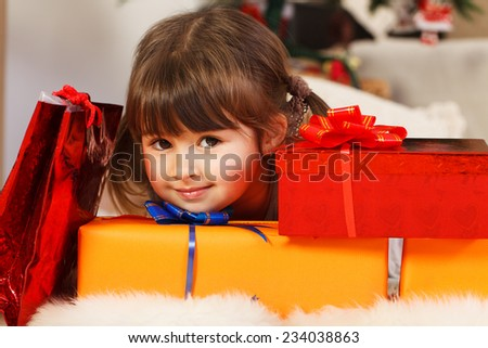 Four years old Girl offering presents.  - stock photo