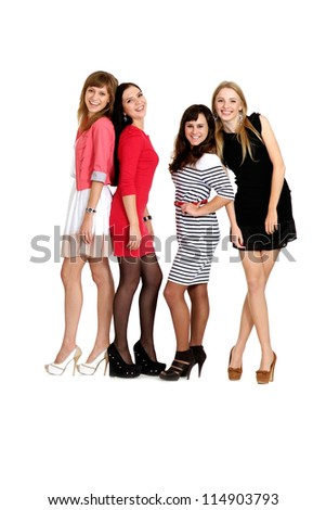Four young girl posing on light background - stock photo