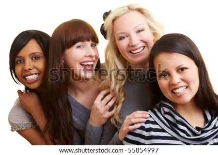 Four young happy smiling women grouped together - stock photo