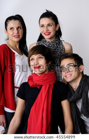 four young people smiling - stock photo