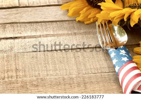 Fourth of July Table Setting on Rustic Board Background with room or space for copy, text, your words.  Horizontal looking down from above - stock photo