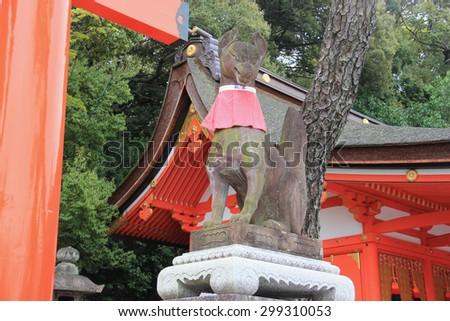 Fox Statues, regarded as the messengers, are often found in Fushimi Inari Taisha Shrine in Kyoto, Japan. - stock photo