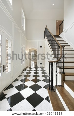 Foyer in luxury home with checkerboard floor - stock photo