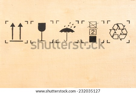 fragile and recycle symbol on wood - stock photo