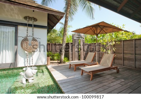 fragment like  view of nice tropical villa with pool - stock photo