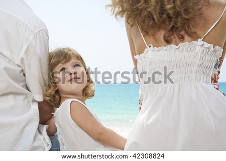 Fragment like view of young family having fun on the beach - stock photo