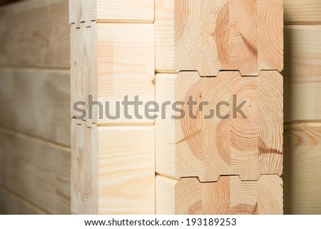 Fragment of a construction built of glued pine timber  beams  - stock photo