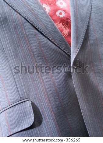 Fragment of a jacket with a tie - stock photo
