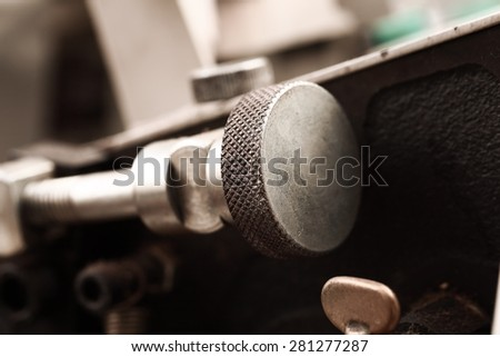 Fragment of a mechanical machine in the industry - stock photo