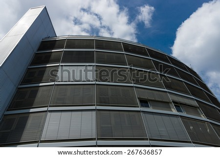 Fragment of a modern building against the sky. - stock photo
