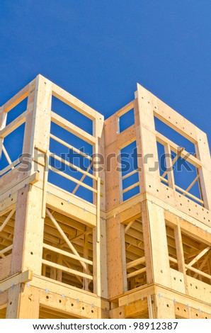 Fragment of a new home under construction over blue sky in Vancouver, Canada. - stock photo