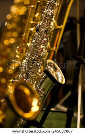 Fragment of a saxophone on a stand - stock photo