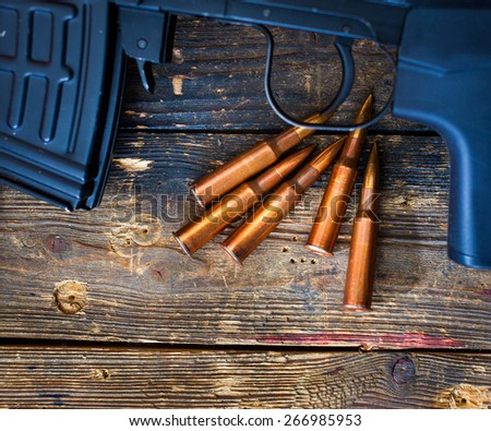 fragment of a sniper rifle SVD with a shop and five cartridges 7.62 cal. - stock photo
