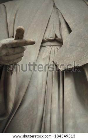 fragment of a statue of Leon Battista Alberti. Statue outside the Uffizi. Florence, Italy  - stock photo