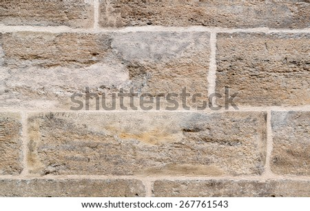 Fragment of a stone masonry wall of stone blocks - stock photo