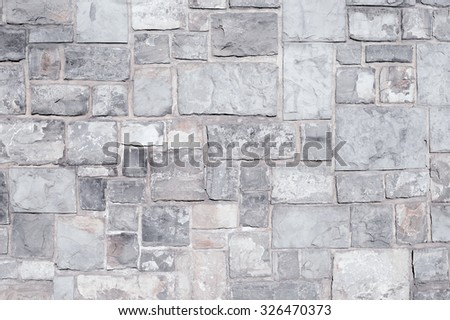 Fragment of a wall from a chipped stone - stock photo