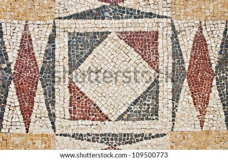 Fragment of an ancient geometrical colorful floor mosaic in Herod`s Palace, Caesarea, Israel - stock photo