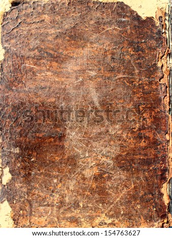 Fragment of an ancient leather handmade book cover as backgrounds  - stock photo