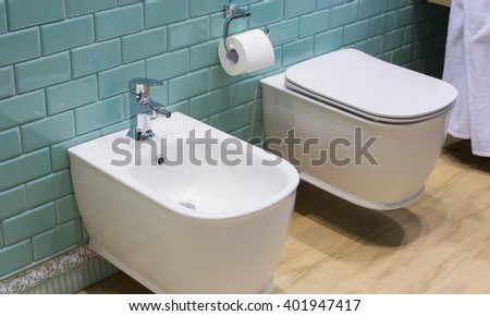 Fragment of bathroom interior: toilet and bidet - stock photo
