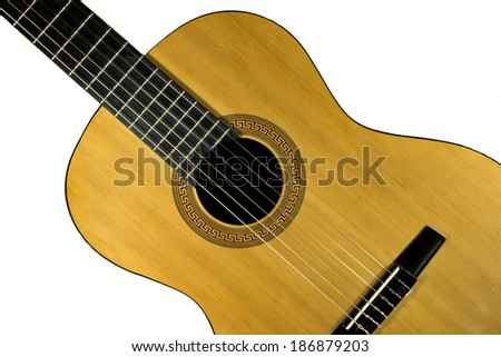 Fragment of classical Spanish guitar on isolated background - stock photo