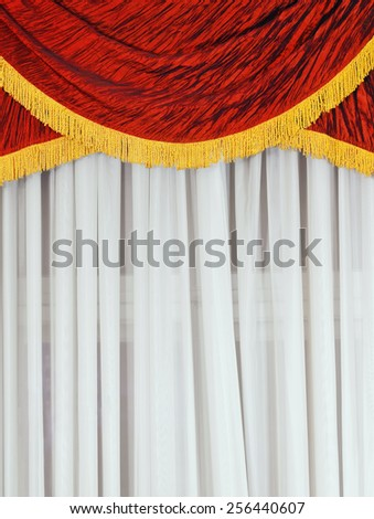 Fragment Of Curtained Window With Tulle And Lambrequin - stock photo